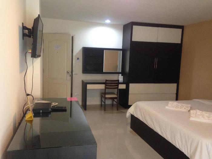 Afbeelding van een slaapkamer van het Similan Mansion.