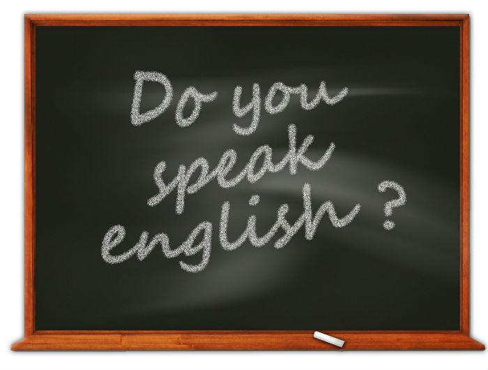 Afbeelding van een krijtbord met de tekst: spreekt u Engels?